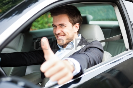 a-man-giving-thumbs-up-while-guy-driving-his-car.jpg